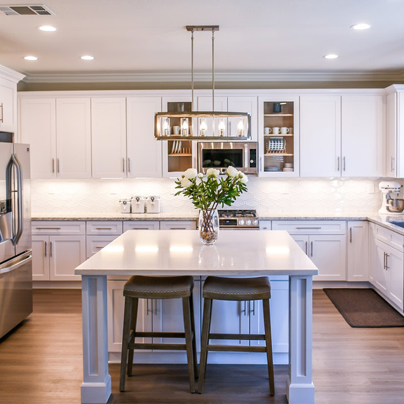 White marble kitchen with island